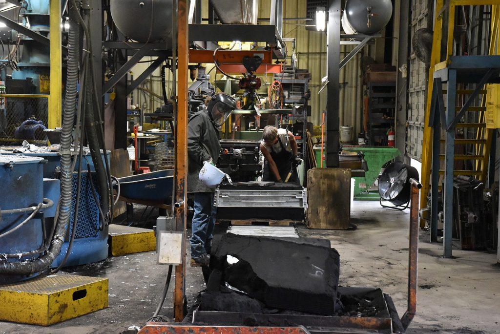 Superior technician pouring aluminum into a mold